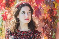 Portrait of fairy autumn girl with red fall wreath Royalty Free Stock Images