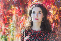 Portrait of fairy autumn girl with red fall wreath Royalty Free Stock Photos