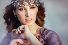 Portrait of a fairy girl with brown hair and a diadem. A portrait of a fairy girl with brown hair and a diadem on a head Stock Photo