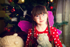 Portrait of fairy girl in front of Christmas tree Royalty Free Stock Photography