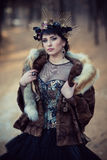 Portrait of fairy girl in furs in the autumn forest stock photography