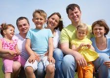 Portrait families with children. Portrait of a cheerful great families with their children outdoor. Seven stock photography