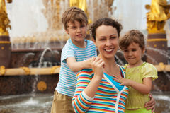 Portrait of family against fountain Stock Photos