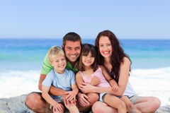 Portrait of a family at the beach Royalty Free Stock Photos