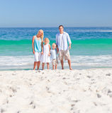 Portrait of a family on the beach Stock Photos