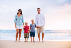 Portrait of Family on the Beach at Sunset. Happy Family of Four on the Beach at Sunset Stock Image