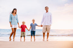 Portrait of Family on the Beach at Sunset. Happy Family of Four on the Beach at Sunset Stock Photography