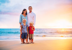 Portrait of Family on the Beach at Sunset Stock Image