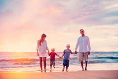 Portrait of Family on the Beach at Sunset. Happy Young Family of Four on the Beach at Sunset Royalty Free Stock Images
