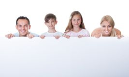 Portrait Of Family Behind Blank Board Stock Photography