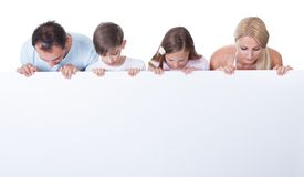 Portrait of family behind blank board Royalty Free Stock Photography
