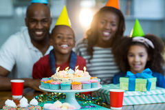 Portrait of family with birthday cake. At home royalty free stock photography