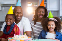 Portrait of family with birthday cake. At home Stock Photography
