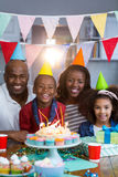 Portrait of family with birthday cake. At home royalty free stock image