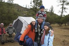 Portrait Of Family Camping. Portrait of happy family with grandparents camping during winter royalty free stock photo