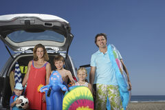 Portrait Of Family With By Car At Beach Royalty Free Stock Images