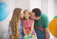 Portrait of a family celebrating birthday of their little daught. Er. Family fun concept royalty free stock photo