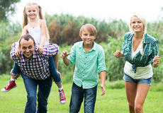 Portrait of family with children. Portrait of cheerful family with children enjoying vacation in park Royalty Free Stock Images
