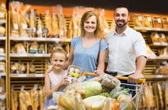 Portrait of family choosing bread and sweets in bakery section Stock Photo