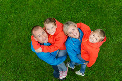 Portrait family in colorful clothes top view. Portrait happy family in colorful clothes top view Stock Photos