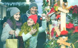 Portrait of family couple with teen girl at  Christmas fair Royalty Free Stock Images