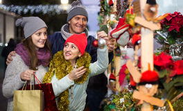 Portrait of family couple with teen girl at  Christmas fair Royalty Free Stock Photos