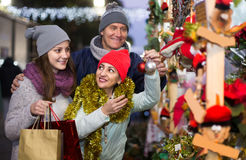 Portrait of family couple with teen girl at  Christmas fair Royalty Free Stock Photo