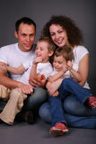 Portrait of family on dark Stock Photos