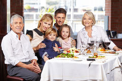 Portrait of a family at dining. Portrait of a happy family with children and grandparents at the dining table stock image