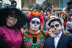 Mexico City, Mexico, ; October 26 2016: Portrait of a family in disguise at the Day of the Dead parade in Mexico City. Portrait of a family in disguise at the royalty free stock photo