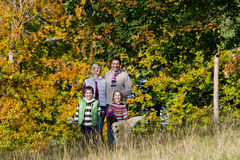 Portrait of family and dog standing in field Royalty Free Stock Image