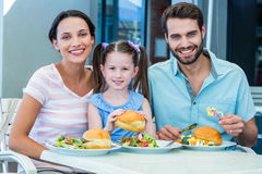 Portrait of a family eating at the restaurant. On a sunny day royalty free stock photos