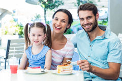 Portrait of a family eating at the restaurant. On a sunny day royalty free stock images