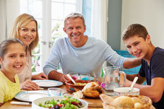 Portrait Of Family Enjoying Meal At Home Together Royalty Free Stock Photography