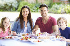 Portrait Of Family Enjoying Outdoor Meal Together Royalty Free Stock Photography