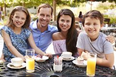 Portrait Of Family Enjoying Snack At Outdoor Caf� Together royalty free stock images