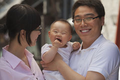 Portrait of family, father holding the baby, Beijing Royalty Free Stock Photos