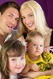 Portrait of a family of four. Closeup portrait of a family of four stock images