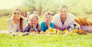 Portrait of family of four lying in the park Stock Image
