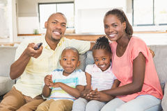 Portrait of a family of four watching tv Royalty Free Stock Image