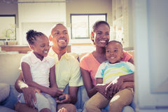 Portrait of a family of four watching tv Royalty Free Stock Images