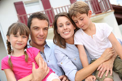 Portrait of family in front of house Stock Photos