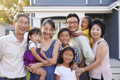 Portrait Of Family With Grandparents Standing Outside House Royalty Free Stock Photos
