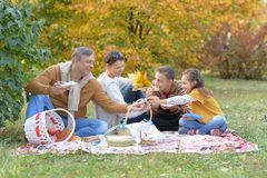 Portrait of family having a picnic in the park in autumn stock photos