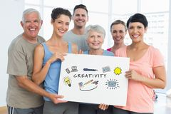 Portrait of family holding billboard with cretivity text and various icosn while standing at home Stock Photography