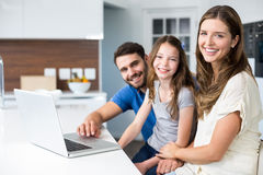 Portrait of family with laptop Royalty Free Stock Photo