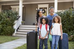Portrait Of Family With Luggage Leaving House For Vacation royalty free stock photography
