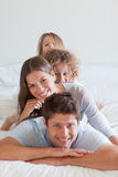 Portrait of a family lying on each other Stock Photos