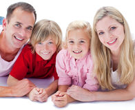 Portrait of family lying on the floor Stock Photos