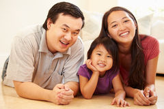 Portrait Of Family Lying On Floor At Home Royalty Free Stock Images